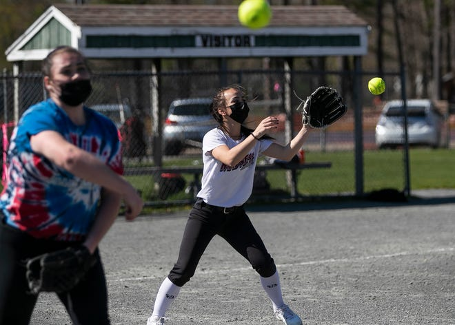 Ava Dipietro, 14, center, makes a catch during Abington High School softball practice on Monday, April 26, 20201.