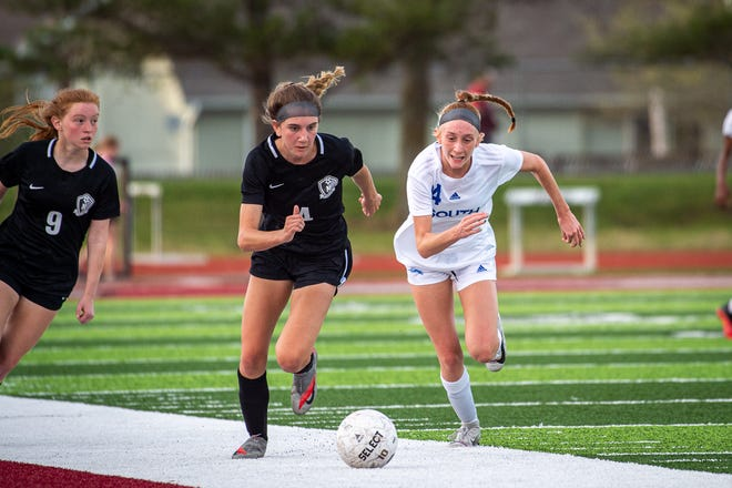 Lee's Summit North's Ashley Borron (4) and Amelia Roller (9) and Blue Springs South's Emma Robinson, right, chase down a loose ball in Monday's game at North. The host Broncos rallied from a 1-0 halftime deficit to claim a 3-1 win.