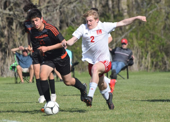 Fort Madison's Austin Miller (2) and Washington's Bryan Arreola battle for possession during the Bloodhounds' 10-3 Southeast Conference victory Monday at Washington.