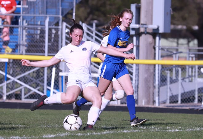 Notre Dame-West Burlington/Danville's Kaitlyn LaLonde gives the ball a kick in their win over Wapello Monday at Wapello.