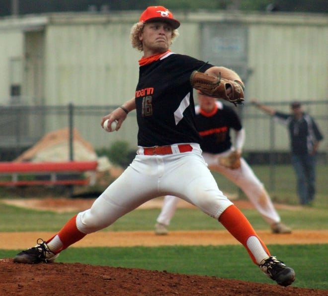 Mandarin's Nathan Webb prepares to deliver a pitch against First Coast during the Gateway Conference high school baseball championship.