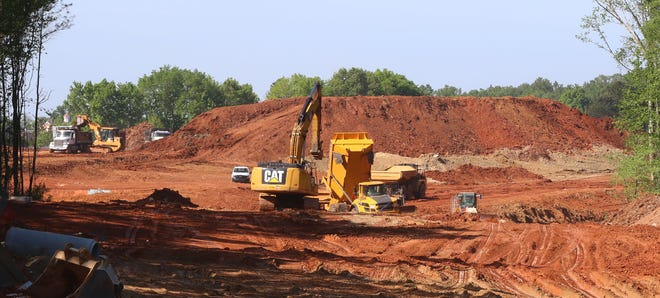 Work continues on clearing the land for a new hospital being built near Belmont Abbey College in Belmont.