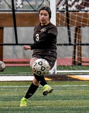 Garden City High School's Thania Flores moves the ball upfield to a teammate in a game earlier this season at Buffalo Stadium.
