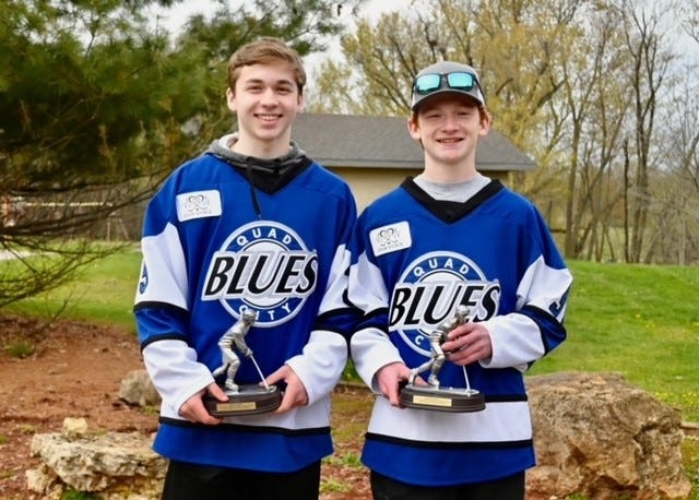 Jase Johnson, left, and Isaiah Conrad, both of Geneseo, and both members of the Quad City Blues High School Hockey Team were among the players honored at the end-of-season event.