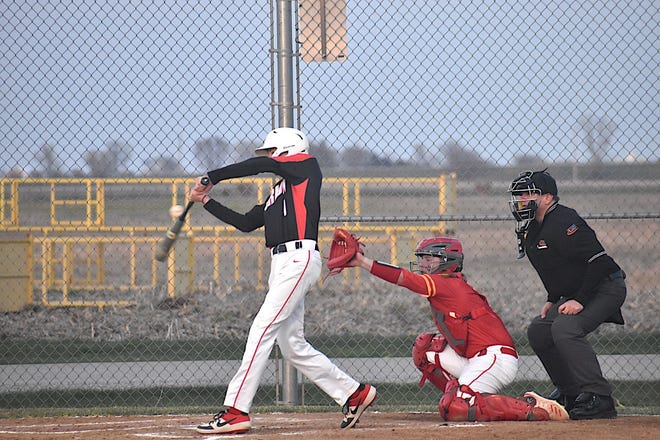 Orion's Dathan Moore makes contact during the second inning of the varsity game with Rock Island on Thursday, April 22, in Love Park