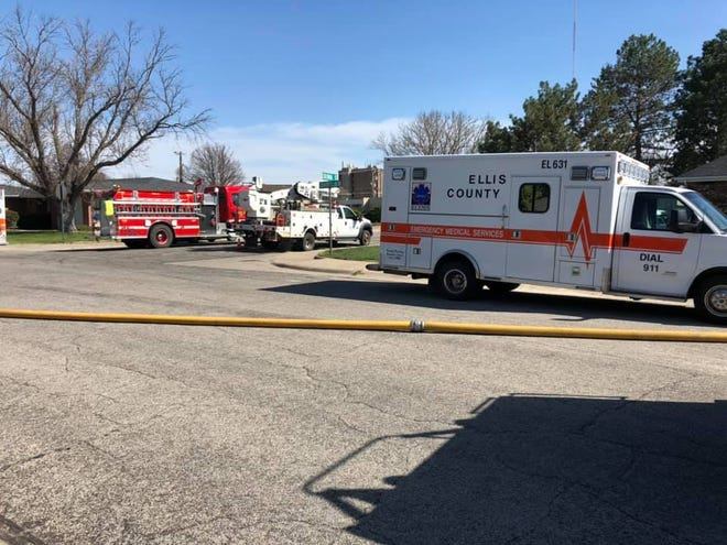 First responders gather Monday near the 1100 block of Country Club Drive where a fire started and spread to nearby homes. [Submitted/Larry Dreiling]