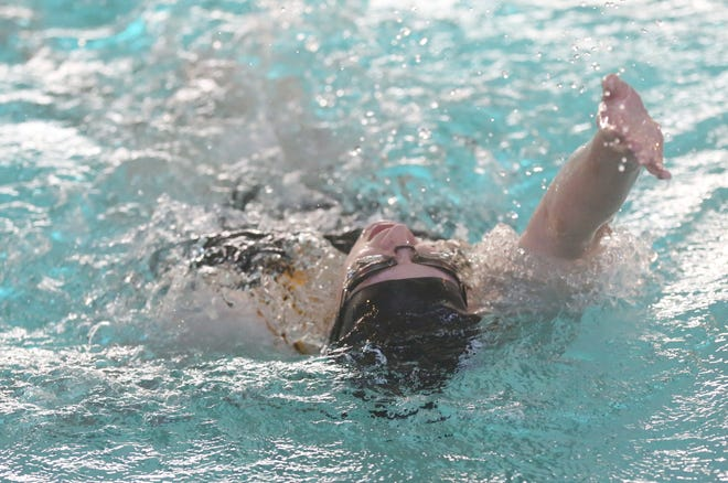 Hays High's Elizabeth Clingan competes in the 100-yard backstroke during the Hays High Invitational on Monday at the Center for Health Improvement. Clingan won the event in 1:15.13.