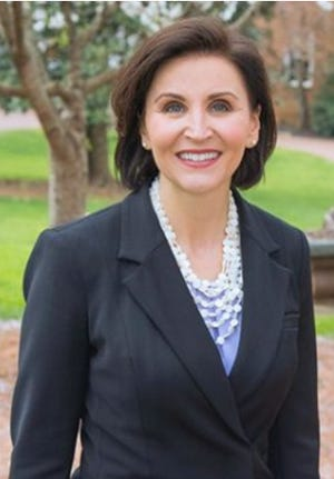 Converse College President Krista Newkirk announced she will step down July 5 and begin duties as president of the University of Redlands in California July 19.