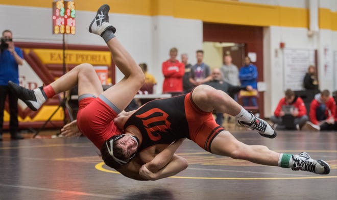 Joey Cape of Washington, right, takes down an opponent during the Mid-Illini Conference wrestling meet last season.