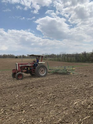 West Carroll FFA President Olivia Charles recently planted on the FFA plot.
