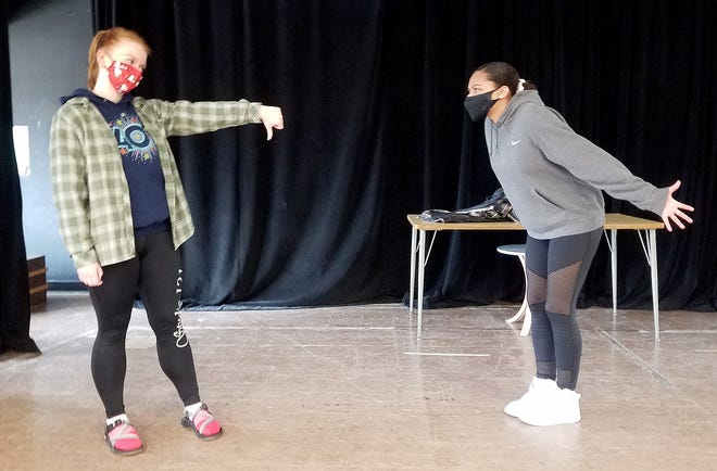"""Brooke Parkinson- (Snoopy), left, rehearses a scene with Kymaira Dixon (Lucy) for the musical """"You're a Good Man Charlie Brown"""" at Freeport High School in Freeport."""