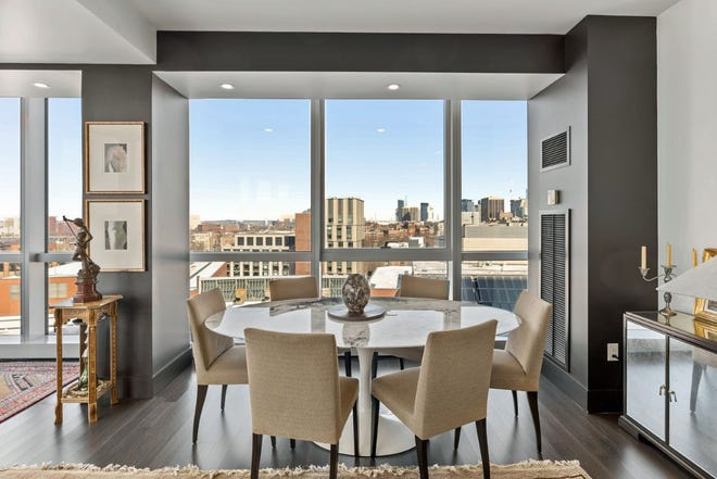 Position the dining table next to the windows to show off the view. At night, you and your guests will enjoy the city lights.