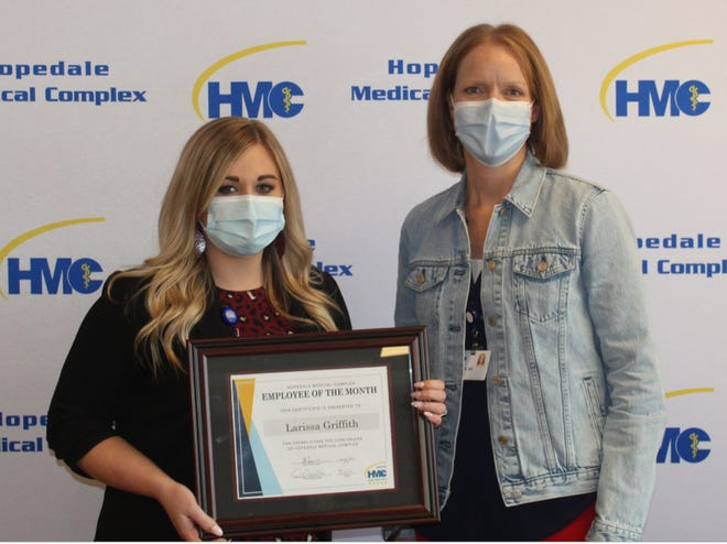 Larissa Griffith, left, is honored as the April Employee of the Month at Hopedale Medical Comples.  Emily Whitson, Chief Operations Officer at HMC, right presents Griffith with a plaque.