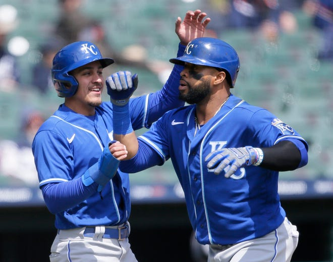 Kansas City Royals' Carlos Santana, right, celebrates with second baseman Nicky Lopez after hitting a two-run home run against the Detroit Tigers during the third inning of a baseball game Monday, April 26, 2021, in Detroit.