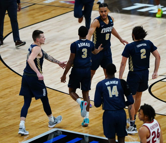Oral Roberts Golden Eagles guard Max Abmas (3) is congratulated after hitting a three point shot during the Sweet Sixteen round of the 2021 NCAA Tournament on Saturday, March 27, 2021, at Bankers Life Fieldhouse in Indianapolis, Ind.