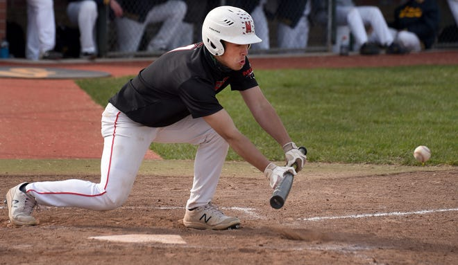 Ryder Knox of Milan puts down a successful bunt to move the runner against Airport Monday, April 26, 2021.