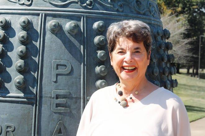 Pat Postma next to the Oak Ridge International Friendship Bell.