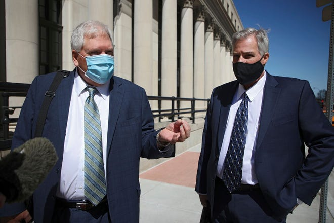 In this April 19, 2021, file photo, former Tulsa Police Officer Shannon Kepler, right, listens as his attorney Stan Monroe speaks outside the Tulsa Federal Building for his fifth trial in the killing of Jeremey Lake, in Tulsa, Okla. A federal jury in Tulsa convicted Kepler, Monday, April 26, 2021, of second-degree murder and assault in the 2014 fatal shooting of his daughter's boyfriend while acquitting him of first-degree murder in the case.