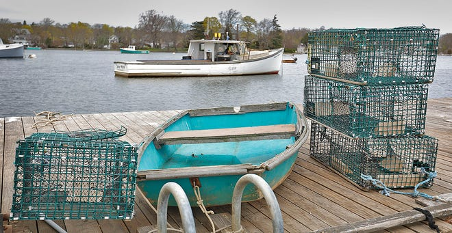 Lobster traps at Cohasset Harbor ready to get back in the water as the right whale migration closure comes to an end on May first. Tuesday April 27, 2021 Greg Derr/The Patriot Ledger