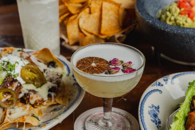 At Rocco's Tacos, a Skinny Margarita shares the stage with loaded nachos and other Cinco-worthy bites.