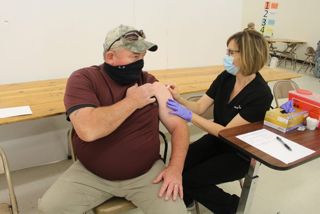 Pratt County nurse Deborah Stegman prepares to administer a Moderna COVID-19 vaccination shot at a mass community clinic earlier this month. After a last clinic this Thursday, those wanting the vaccination shots will need to make appointments at the Pratt County Health Clinic or at other administration sites in the county.