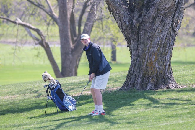 Dalton Scott lines up his shot on Saturday, April 24 during a home tournament at the Perry Golf and Country Club.