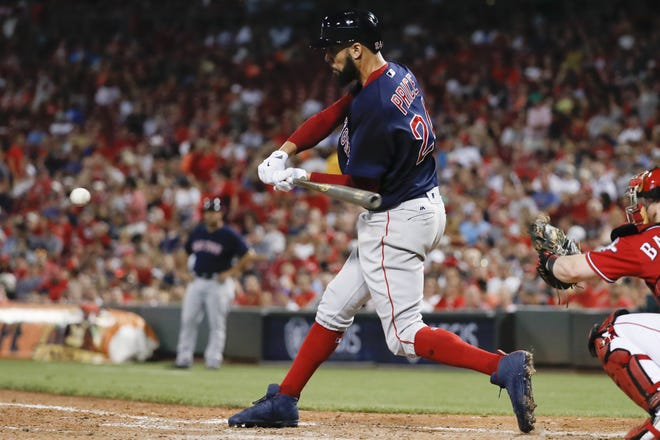 Boston Red Sox's David Price hits a single off Cincinnati Reds relief pitcher Asher Wojciechowski during the seventh inning of a baseball game, Friday, Sept. 22, 2017, in Cincinnati. (AP Photo/John Minchillo) ORG XMIT: OHJM119