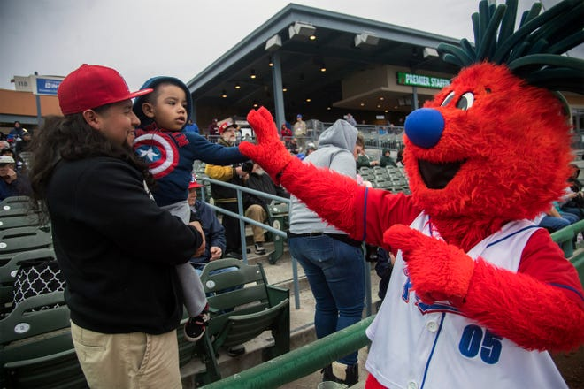 Ports' mascot Splash gives a high five on opening day in April 2018 at Stockton Ballpark in downtown Stockton.