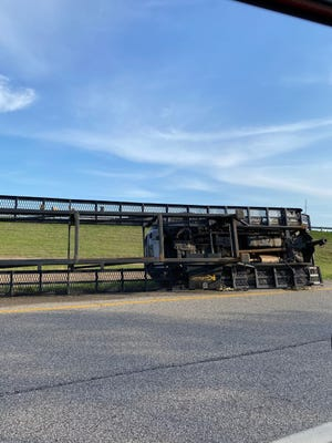 A vehicle carrier turned over on its side on the onramp to Interstate 76 in Rootstown Monday. The Ohio Highway Patrol investigated the crash.