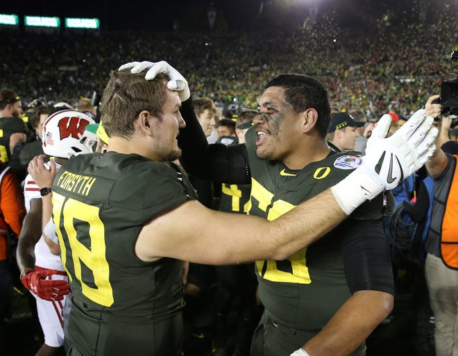 Alex Forsyth, left, and Penei Sewell celebrate their victory over Wisconsin in the Jan. 1, 2020, Rose Bowl in Pasadena, Calif.