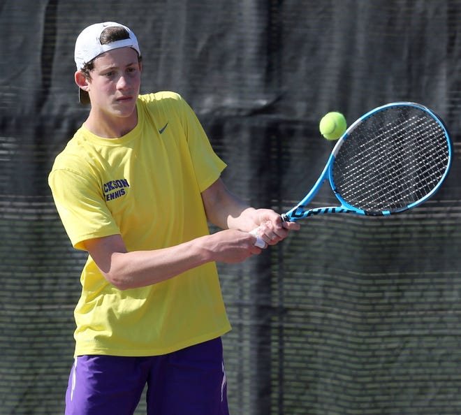 Jackson's Alvin Altman returns a volley against Hoover's Colin Fitzgerald during their No. 1 singles match this week.