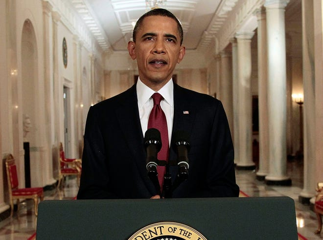 In this May 1, 2011, photo, President Barack Obama reads a statement to photographers after making a televised statement on the death of Osama bin Laden from the East Room of the White House.