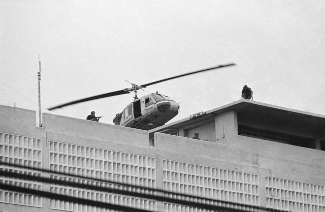 A U.S. Marine helicopter takes off from helipad on top of the American Embassy in Saigon, Vietnam on April 30, 1975.