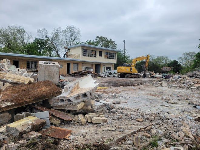 Crews began demolishing the Kickapoo Motel this week.