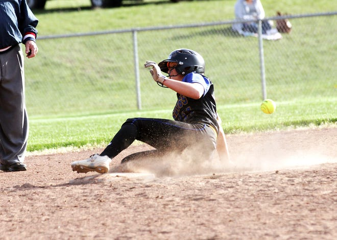Centreville's Kamryn Troyer slides safely into second base to record a steal against Decatur on Monday evening.
