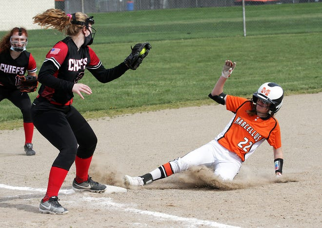 Marcellus' Layni Heuring slides safely into third base on Monday afternoon.