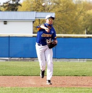 Centreville shortstop Henrik Payne fires over to first base to record an out against Decatur on Monday evening.