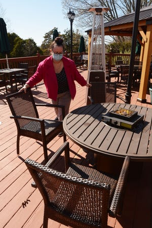 Lisa Zibbideo, restaurant manager at The Spa at Norwich Inn, on the outdoor dining area Monday. [John Shishmanian/ NorwichBulletin.com]