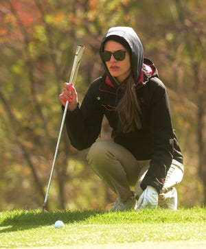Bacon Academy's Gianna Duckworth lines up her putt  during a match against NFA at the Norwich Golf Course.