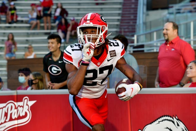 Georgia defensive back Eric Stokes celebrates after returning an interception for a touchdown during a game last September at Arkansas.