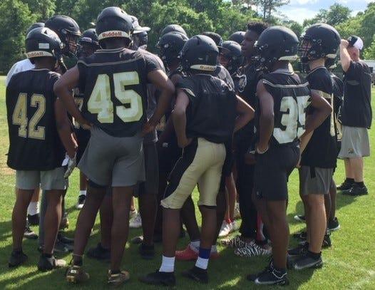 Buchholz High's defense huddles up at practice Monday.