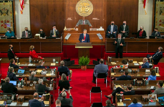 Gov. Roy Cooper delivers his State of the State address before a joint session of the North Carolina House and Senate on Monday in Raleigh. [Robert Willett/The News & Observer via AP]
