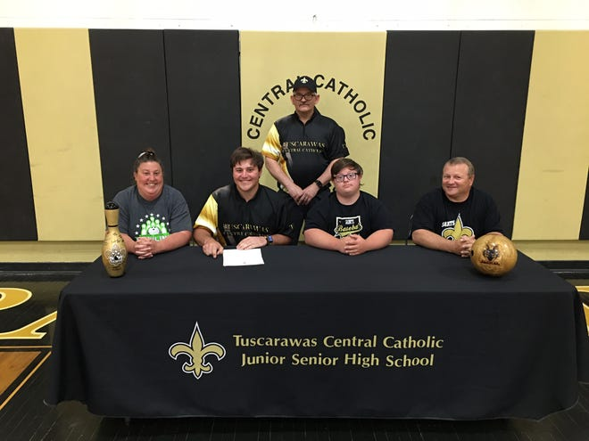 Tuscarawas Central Catholic's Bailey McGinnis signed a letter of intent Tuesday to bowlfor Walsh University. McGinnis plans on pursuing a degree in law. In attendance for his signing are his parents Frittz and Denise McGinnis along with his brother Austin and head bowling coachat Tuscarawas Central Catholic Scott McIntyre.
