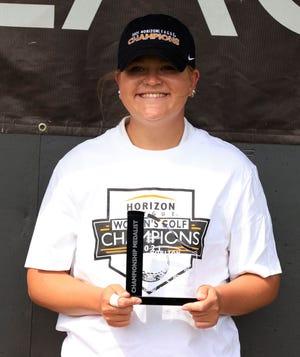 Katlyn Shutt displays her championship hardware.