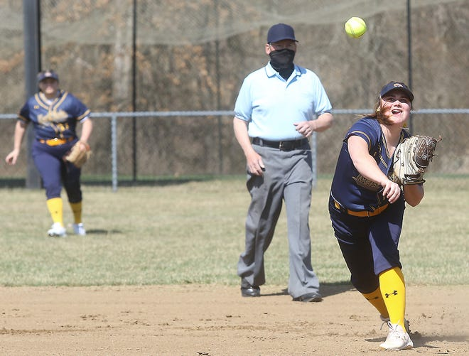 Harley Mason throws to first after fielding a grounder against Lakeland CC.
