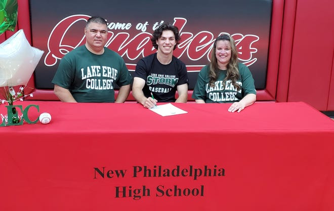 New Philadelphia senior Connor Shimek, seated between his father and mother John and Kelly, will play baseball at Lake Erie College