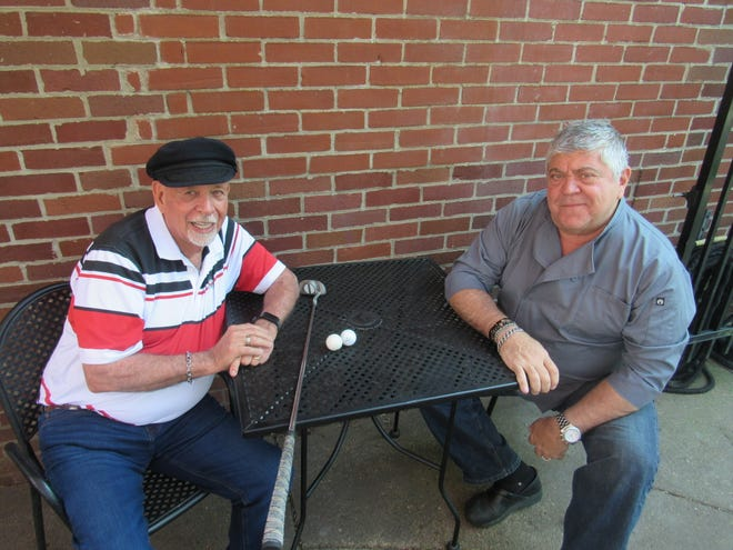 Wayne Owens (left) and George Stefanidis sit on the patio at Stefanidis' pub, the Red Brick Tap & Grill, 292 E. Gates St. The Red Brick is the last stop on this year's Pub Golf Tour, of which Owens is director.