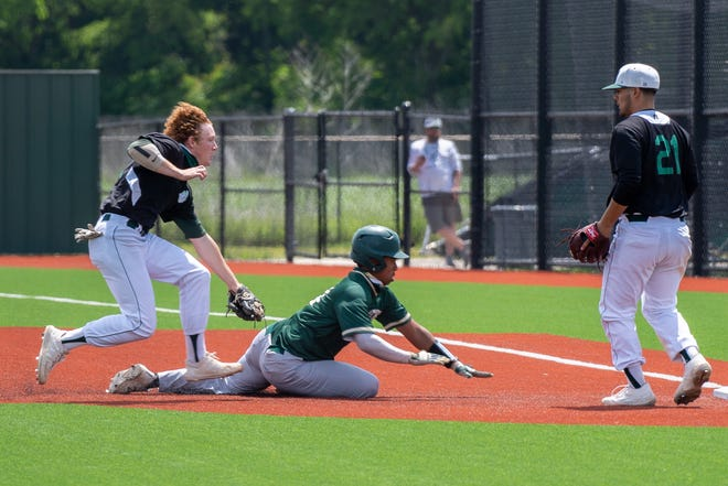 Waxahachie's Lucas Ferguson, left, tags out a DeSoto base runner in a rundown as Anthony Mata (21) covers first base during Saturday afternoon's District 11-6A game at the Midkiff Athletic Complex. The Indians won, 5-4.