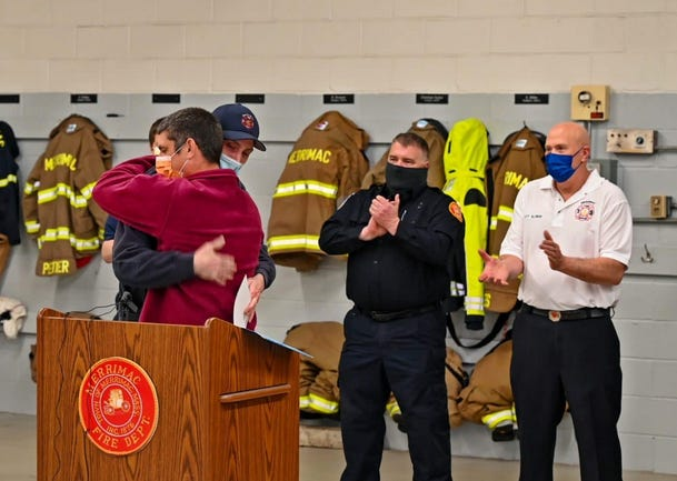 David Lesiczsa of Haverhill, right, hugs Merrimac Firefighter/EMT William Howard during a ceremony on April 19, where Lesiczsa was reunited with those who saved his life during a serious crash this past fall.