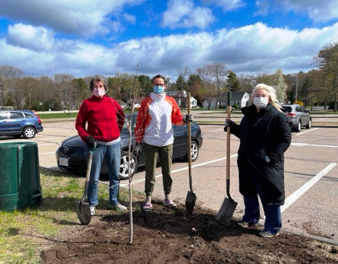 Members of the Franklin Interfaith Council churches pause for a photo after planting a tree in honor of Earth Day.
